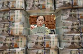 चीन का विदेशी मुद्रा भंडार 30 खरब डॉलर से अधिक