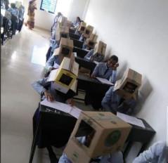 नकल रोकने अनोखा तरीका, छात्रों को पहना दिए कार्डबोर्ड के डिब्बे