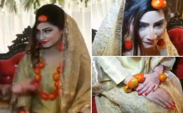 पाकिस्तान में दुल्हन ने पहने टमाटर के गहने, देखें वीडियो