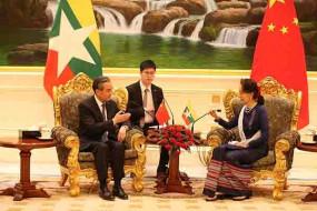वांग यी ने म्यांमार की विदेश मंत्री ऑन्ग सान सू की के साथ मुलाकात की