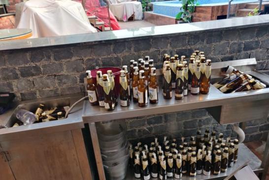 मध्य प्रदेश में शराब की बोतलों के साथ फोटो वायरल होने पर 3 पटवारी निलंबित