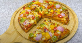 Pizza: गेहूं के आटे वाला तवा पिज्जा बढ़ाएगा आपके मुंह का जायका, जानें रेसिपी