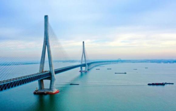 China: चीन में विश्व का पहला रिवर क्रॉस राजमार्ग व रेलवे पुल स्थापित