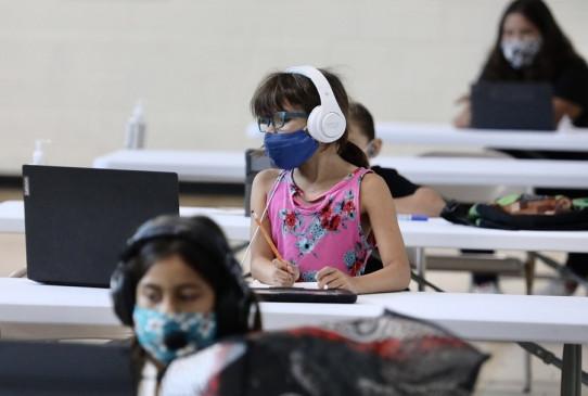 अमेरिका में करीब 550,000 बच्चे कोविड-19 से संक्रमित