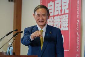 जापान अगले साल ओलंपिक के आयोजन को लेकर प्रतिबद्ध : सुगा