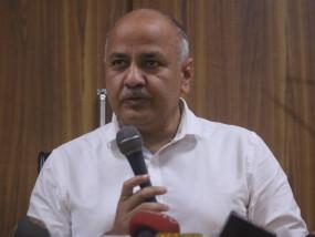 उपमुख्यमंत्री: दिल्ली में सख्ती जरूरी, लोगों को बांटे मास्क