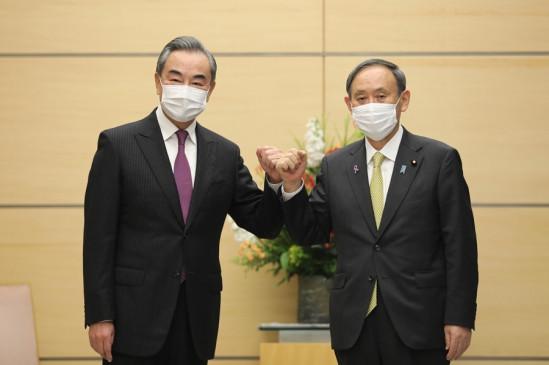 जापानी प्रधानमंत्री योशीहिदे सुगा की वांग यी से मुलाकात
